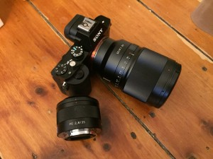 A7R with lens attached, next to the older 35mm f/2.8