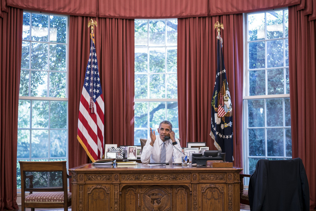President Barack Obama talks on the phone with Cuba President Raúl Castro in the Oval Office, Sept. 18, 2015. (Official White House Photo by Pete Souza)