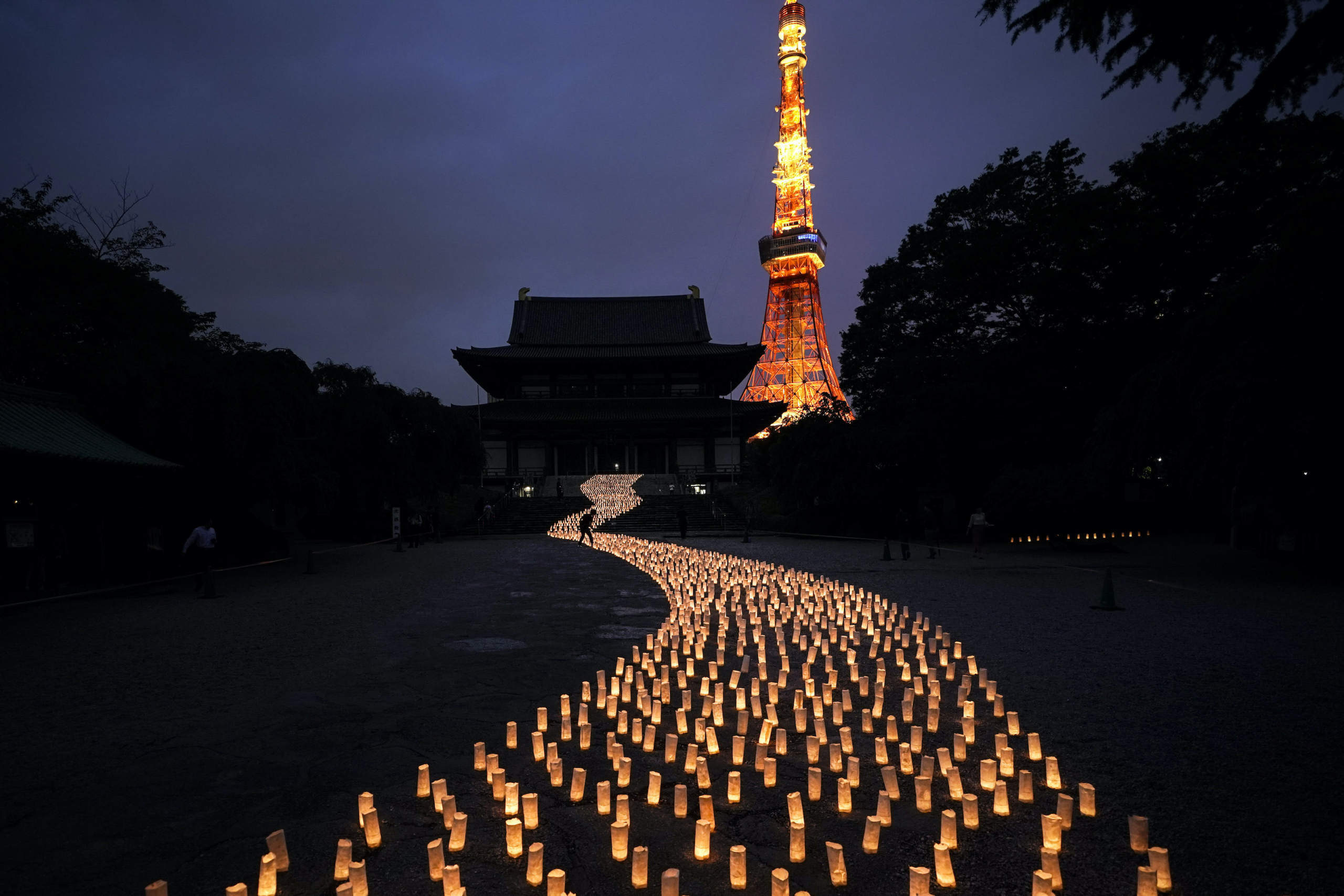 In this photo shot on Sony equipment, thousands of candles are arranged in the shape of the Milky Way to celebrate Tanabata, a Japanese star festival, at Zojoji Temple, July 5, 2019, in Tokyo. (AP Photo/Jae C. Hong)